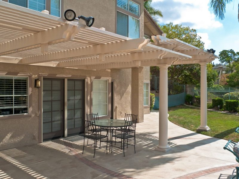 Exterior of an Open Lattice Patio Cover with LED lights facing the customer's home in Orange County, CA