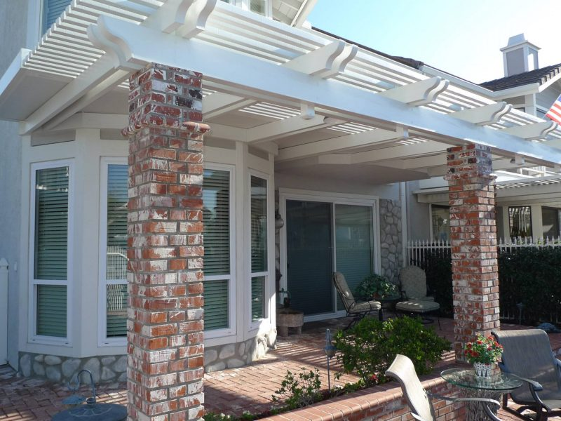 Exterior of Combination Open Lattice & Solid Insulated Patio Cover with brick columns facing the home.