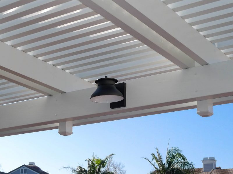 Detail picture of LED light affixed to a double header beam on inside of Combination Open Lattice Patio Cover project.