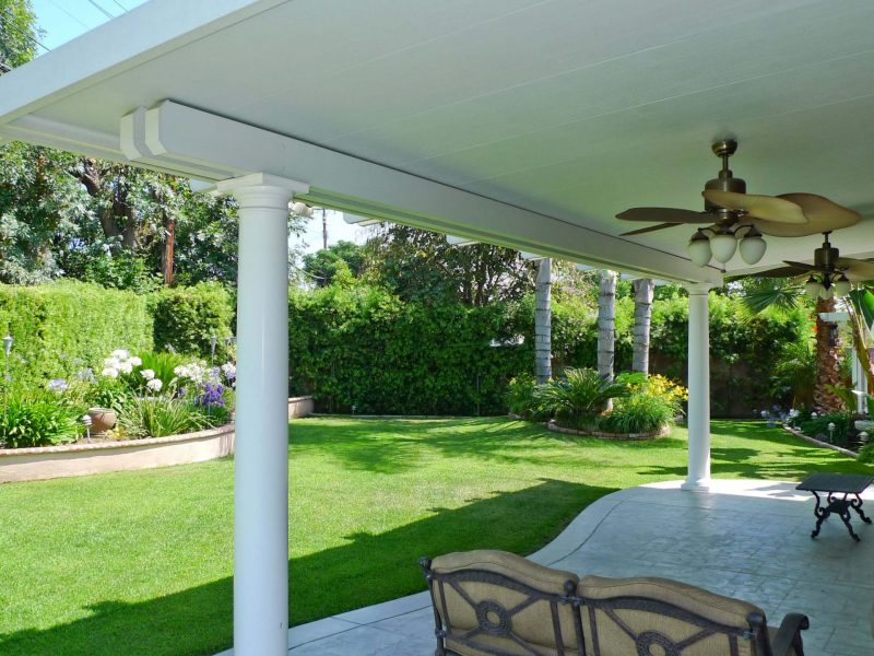 Exterior of a Solid Insulated Patio Cover with Roman columns and 2 Ceiling Fans in Placentia, CA