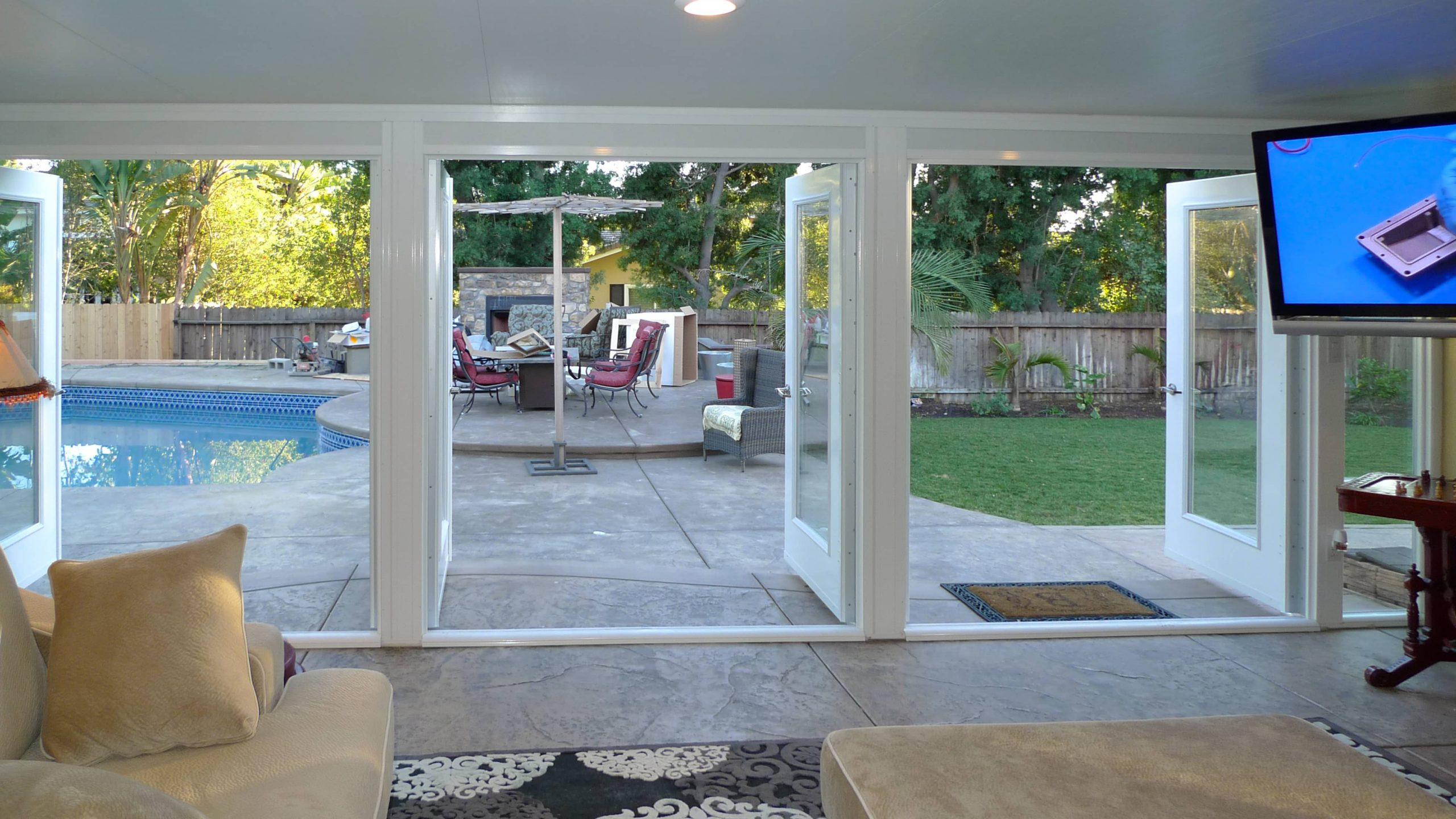 Interior of a Garden Room made into a TV room showing 3 sets of French Doors in Trabuco Canyon, CA