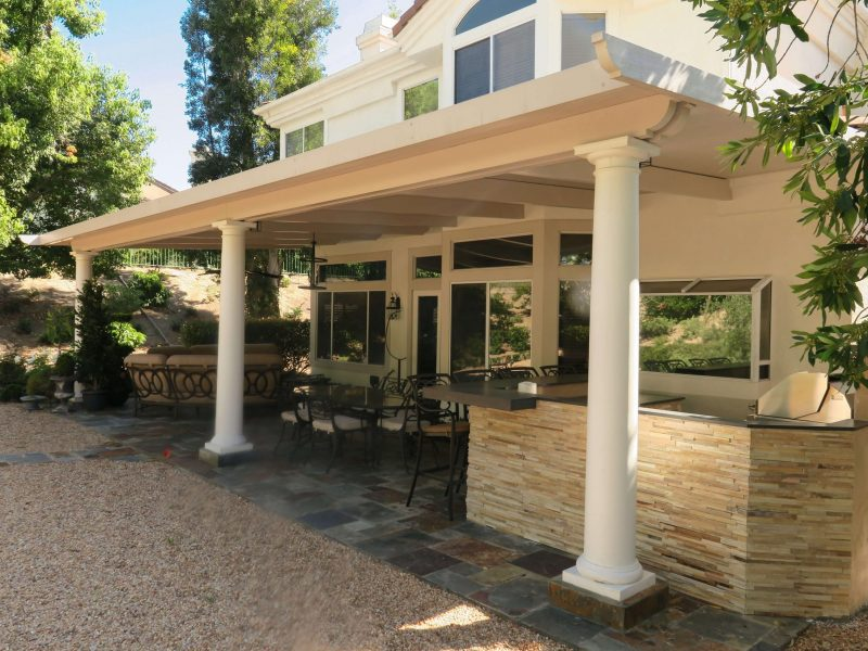 Exterior of a Solid Insulated Patio Cover with Roman columns and an LED Light in Dove Canyon, CA