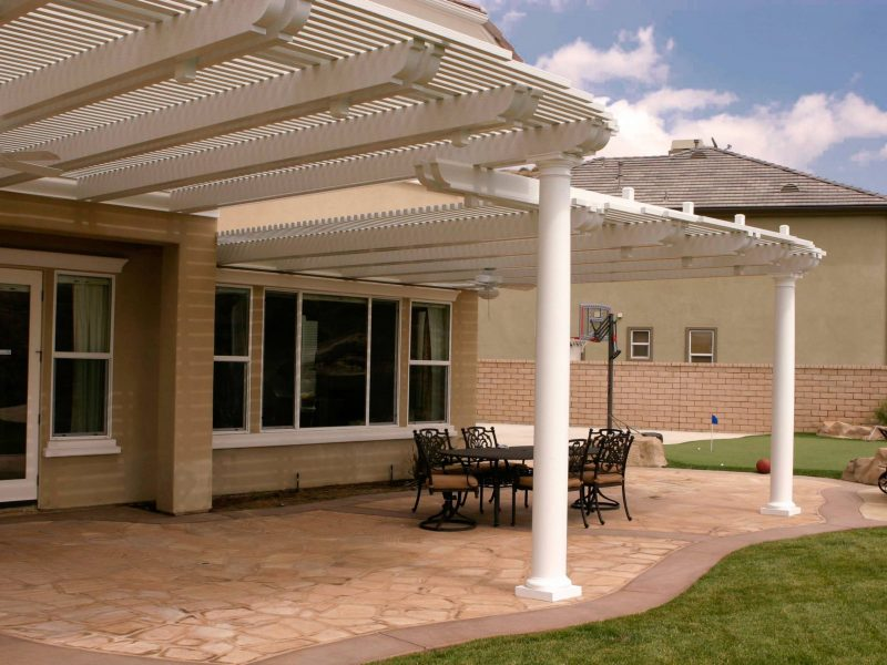 Exterior of an Open Lattice Patio Cover with a Roman Columns, LED lights & ceiling fan, facing the home in Orange County, CA