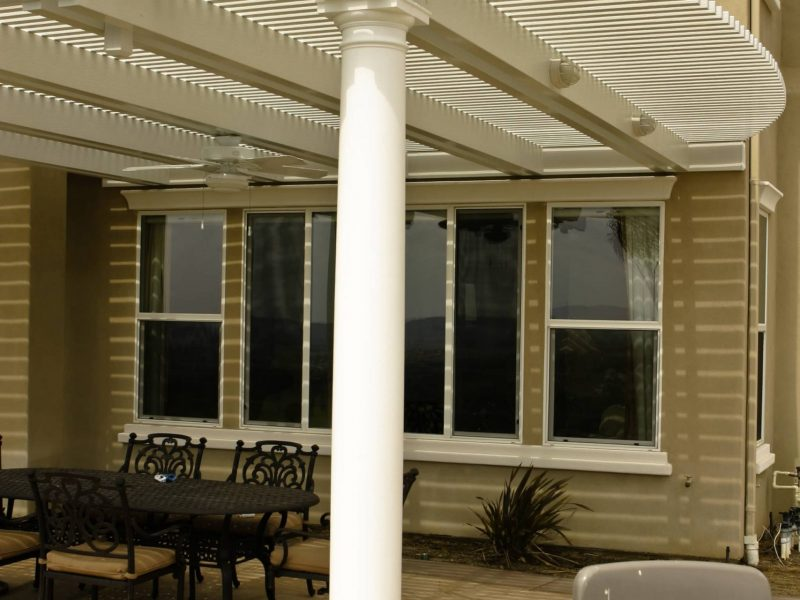 Exterior of an Open Lattice Patio Cover with a Roman Column, facing the home in Orange County, CA