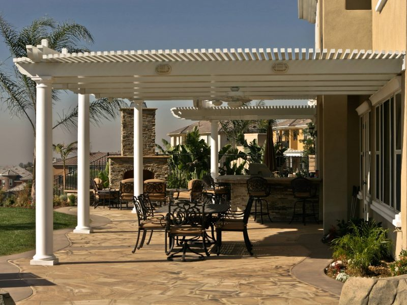 Side View of an Open Lattice Patio Cover with Roman Columns, LED lights and ceiling fan in Orange County, CA