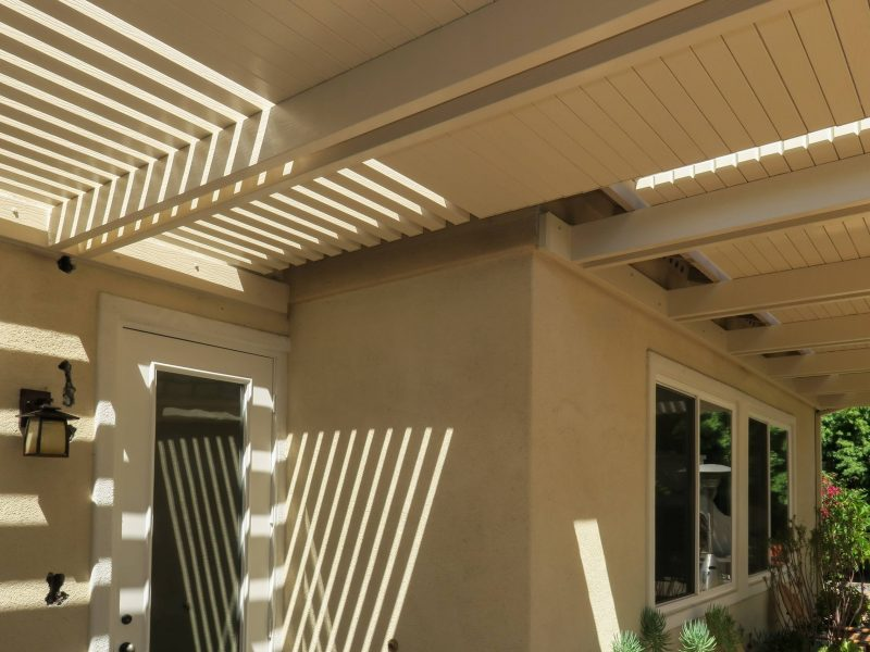 Underside of an Open Lattice Patio Cover with Solid style Lattice Concept Sections facing the house
