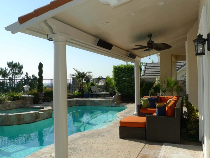 Exterior of a Solid Insulated Patio Cover with a Ceiling Fan, 2 heaters, LED lights, Roman Columns and patio furniture in Yorba Linda, CA