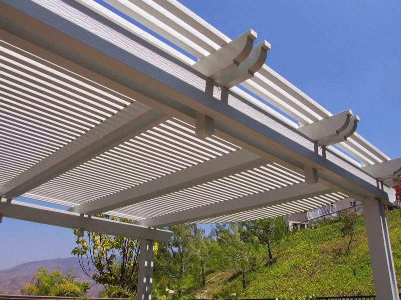 Underside of an Open Lattice Patio Cover showing detail of 3 sets of double rafters with corbel end cuts in Ladera Ranch, CA