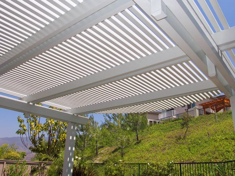Underside of an Open Lattice Patio Cover showing detail of 3 sets of double rafters with corbel end cuts in Stanton, CA
