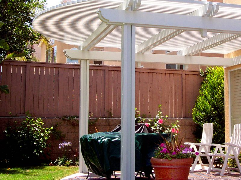 Exterior of an Open Lattice Patio Cover with a radiused curve cut in the front in Ladera Ranch, CA