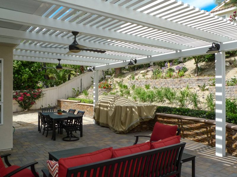 Side View of Combination Open Lattice Patio Cover with LED lights on Header beam, 2 ceiling fans and patio furniture