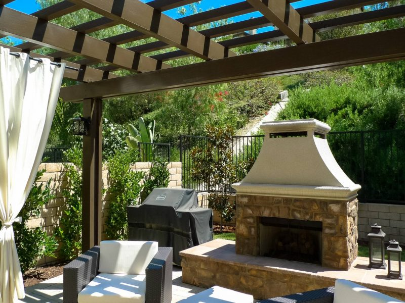 Underside of an Open Lattice Patio Cover showing patio furniture, BBQ and outdoor fireplace in Laguna Niguel, CA