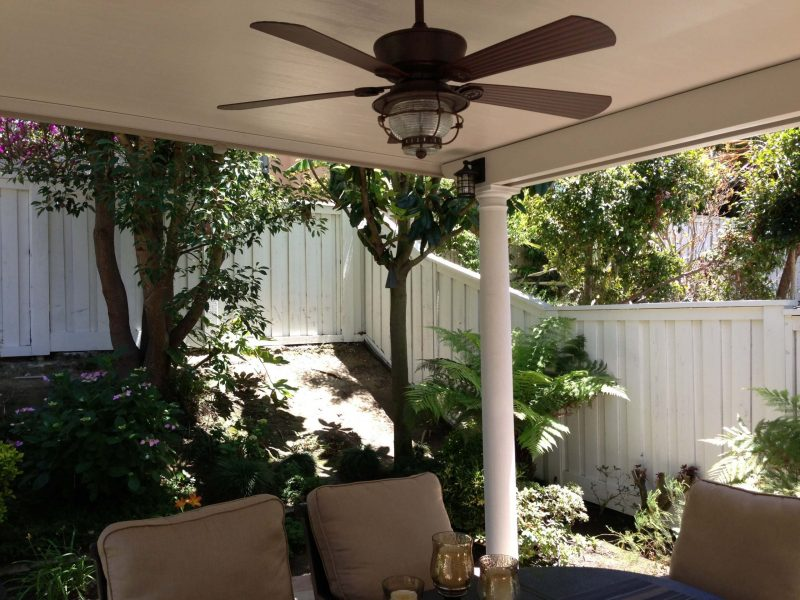 Underside of a Solid Insulated Patio Cover with a Ceiling Fan, LED Light, Roman Column and furniture in Whittier, CA