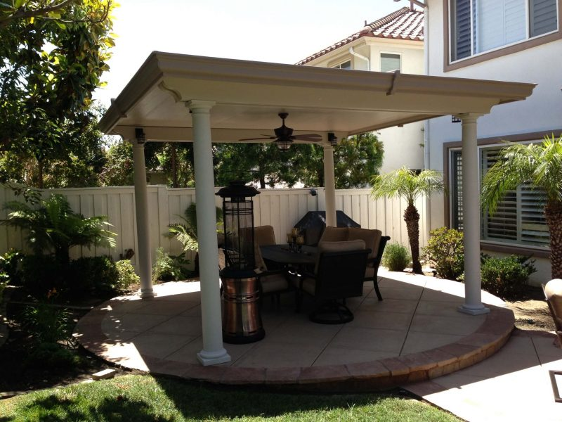 Exterior of a Freestanding Solid Insulated Patio Cover with a Ceiling Fan, LED Light, Roman Column and furniture in Whittier, CA