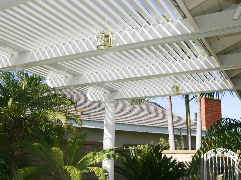 Underside of an Open Lattice Patio Cover showing a Roman Column & LED lights in Orange County, CA