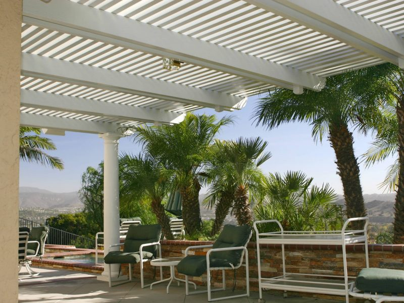 Underside of an Open Lattice Patio Cover showing a Roman Column, patio furniture & LED lights in Orange County, CA