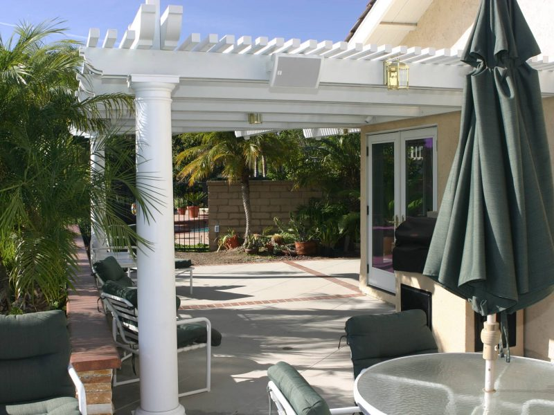 Exterior of an Open Lattice Patio Cover with LED Lights, Speakers & Roman Columns in Mission Viejo, CA