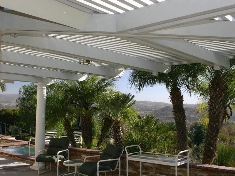 Underside of an Open Lattice Patio Cover showing a Roman Column, LED lights and an intricate rafter design in Orange County, CA