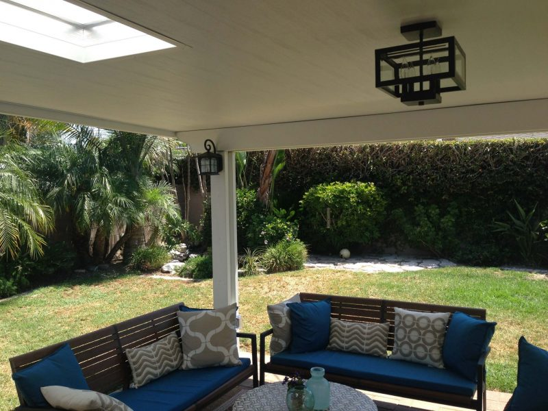 Underside of a Solid Insulated Patio Cover with LED Lights, a skylight and patio furniture in Los Alamitos, CA