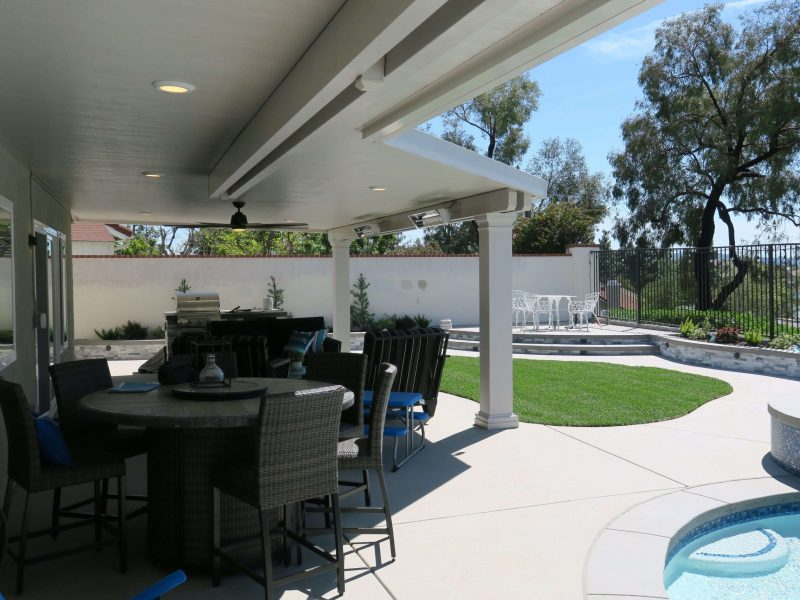 Underside of a Solid Insulated Patio Cover with LED Lights, Ceiling Fan and Square Columns in Tustin, CA