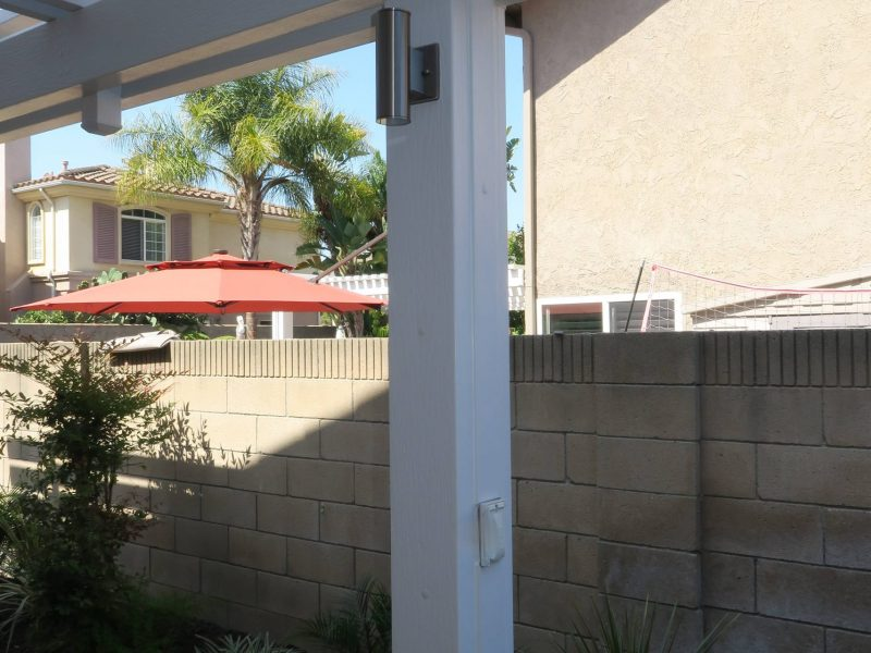 Post Detail of an Open Lattice Patio Cover with an LED Light and Electrical Receptacle in post in Orange County, CA