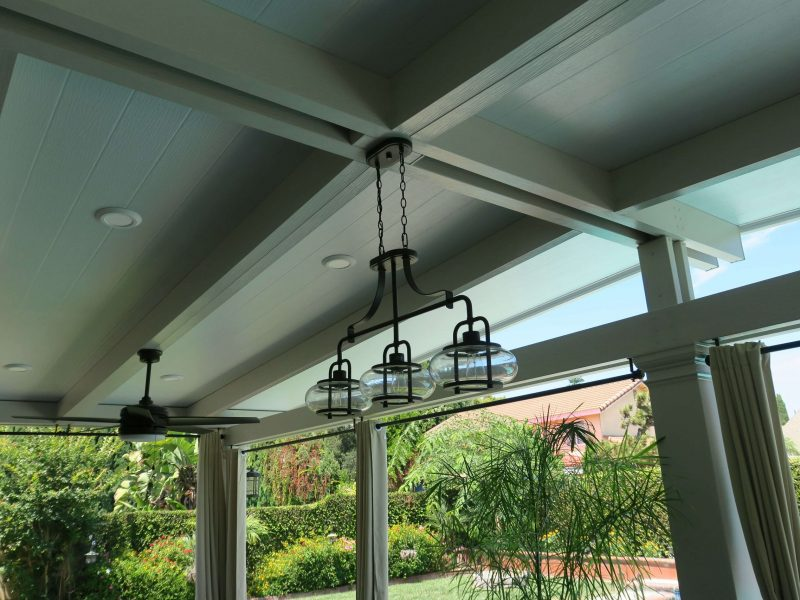 Underside of a Solid Insulated Patio Cover with LED Lights, Ceiling Fan and Square Columns in Lake Forest, CA