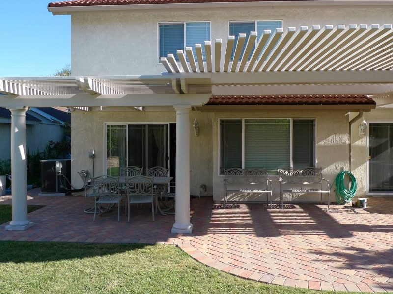 Exterior of an Open Lattice Patio Cover with a radiused curve cut in the front & Roman Columns in Brea, CA