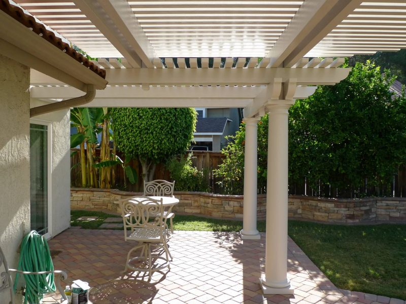 Underside of an Open Lattice Patio Cover with a radiused curve cut in the front & Roman Columns in Brea, CA