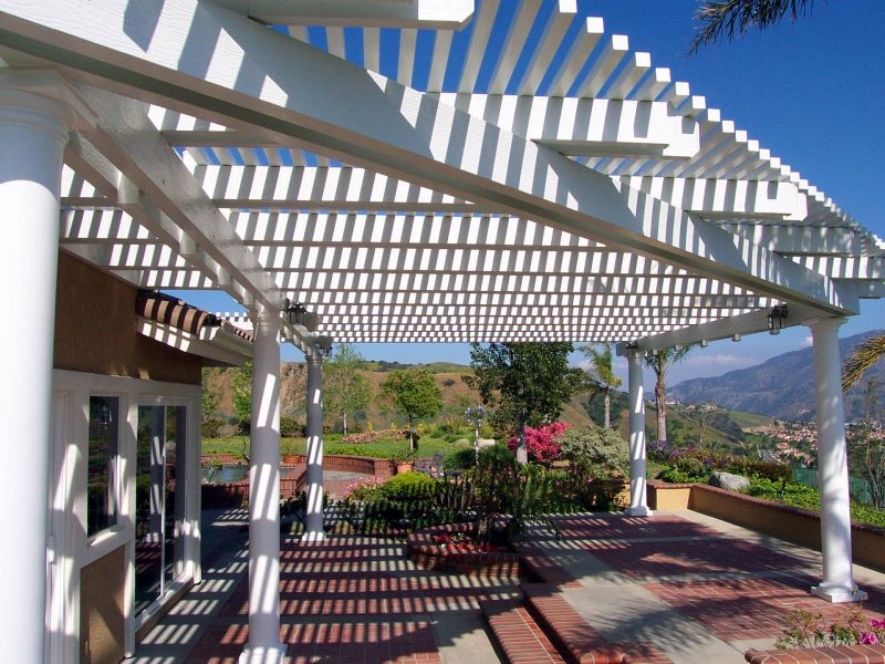 Exterior of an Open Lattice Patio Cover LED Lights & Roman Columns in Orange County, CA
