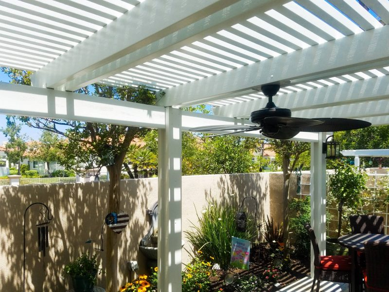 Underside of an Open Lattice Patio Cover showing a ceiling fan & LED light in Aliso Viejo, CA