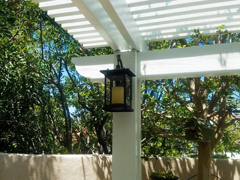 Underside of an Open Lattice Patio Cover showing a detail of an LED light on a post in Aliso Viejo, CA