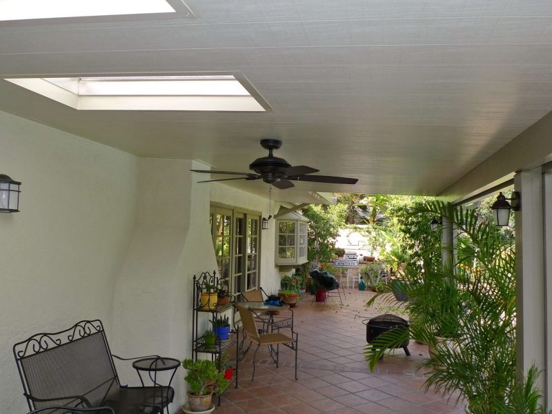 Underside of a Solid Insulated Patio Cover with LED Lights, a Ceiling Fan and 2 Skylights in Santa Ana, CA