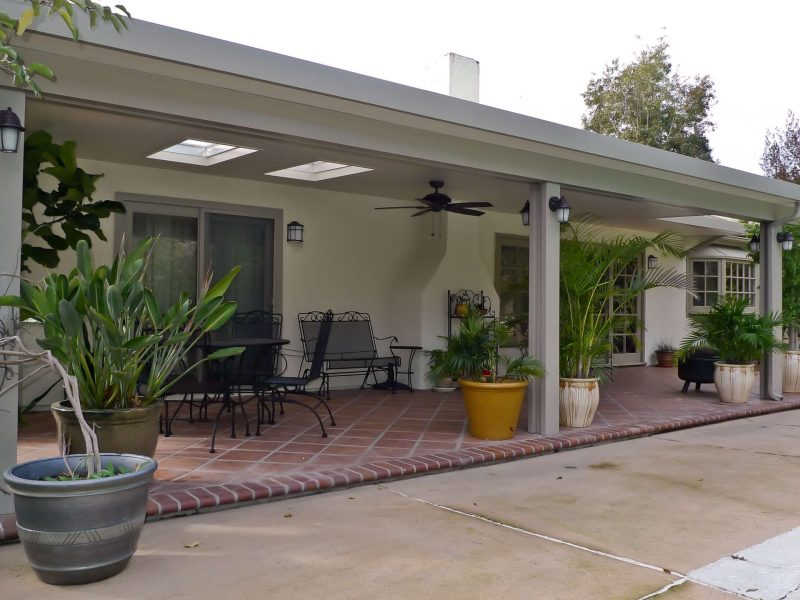 Exterior of a Solid Insulated Patio Cover with LED Lights, a Ceiling Fan and 2 Skylights in Santa Ana, CA