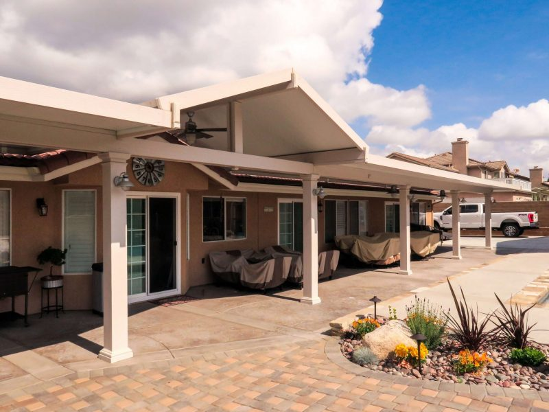 Exterior of a Solid Insulated Patio Cover with LED Lights & 4 Ceiling Fans in Norco, CA