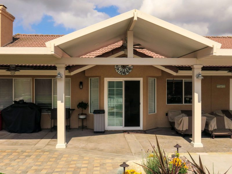 Exterior of a Solid Insulated Patio Cover with LED Lights & 3 Ceiling Fans in Norco, CA