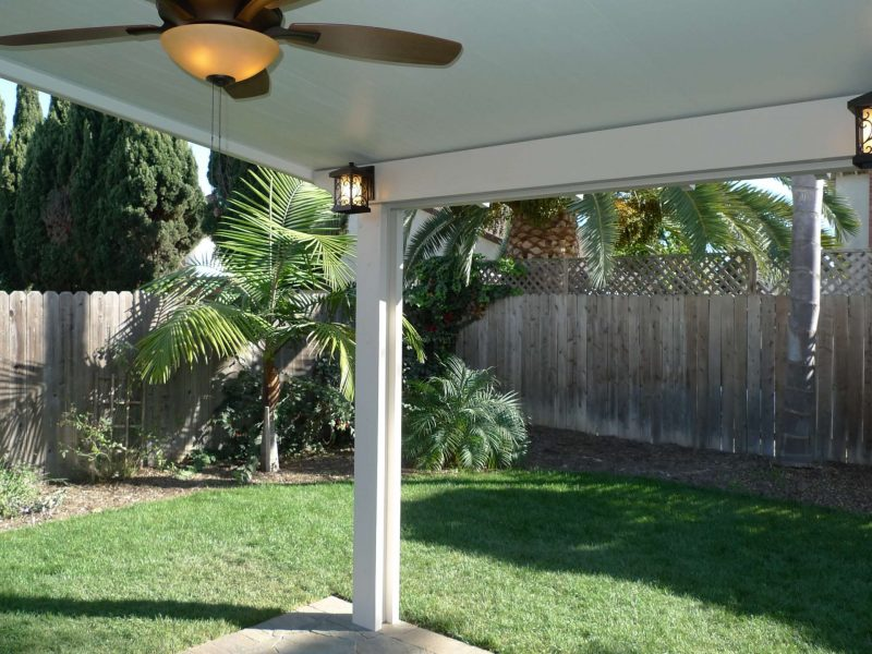 Underside of a Solid Insulated Patio Cover with a Ceiling Fan and LED Lights in Orange, CA