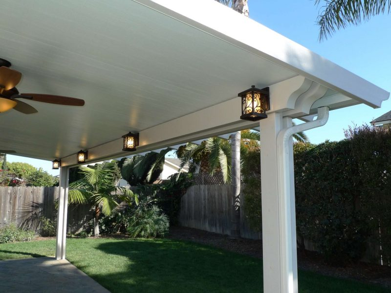 Exterior of a Solid Insulated Patio Cover with LED Lights and 2 Ceiling Fans in Seal Beach, CA