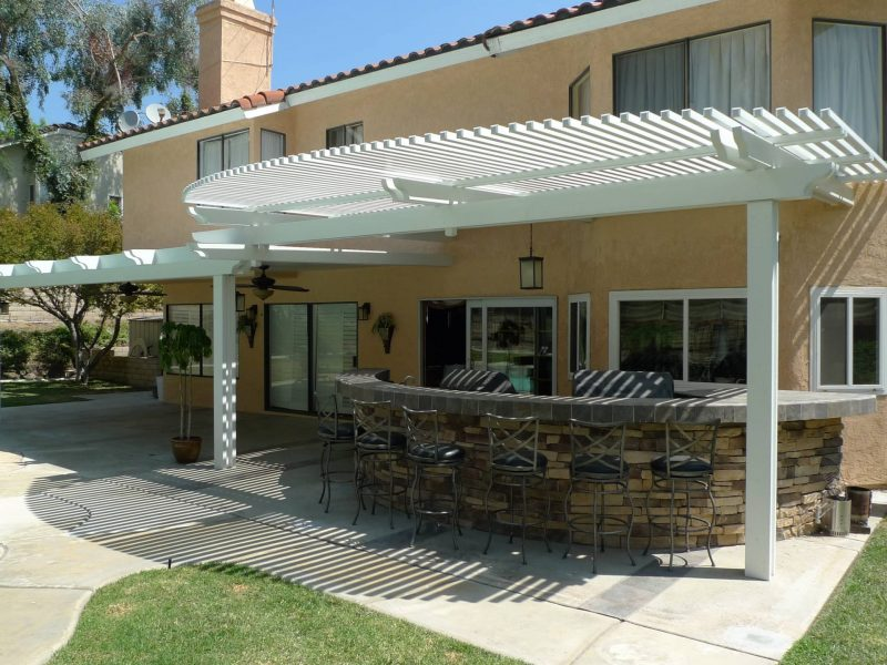 Exterior of Combination Open Lattice & Solid Insulated Patio Cover with LED lights facing the home.