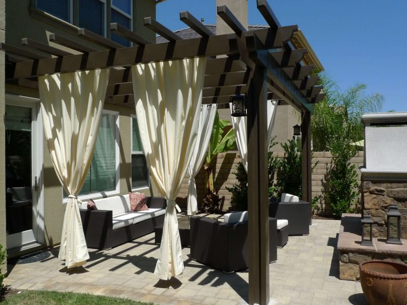 Exterior of an Open Lattice Patio Cover showing patio furniture and outdoor fireplace in Laguna Niguel, CA