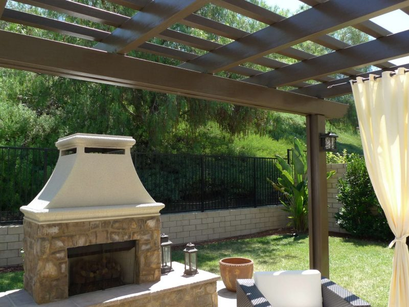 Underside of an Open Lattice Patio Cover showing patio furniture and outdoor fireplace in Laguna Niguel, CA