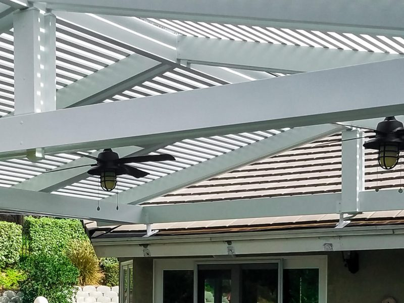 Underside of a Gabled Open Lattice Patio Cover with 2 Ceiling Fans in Santa Ana, CA