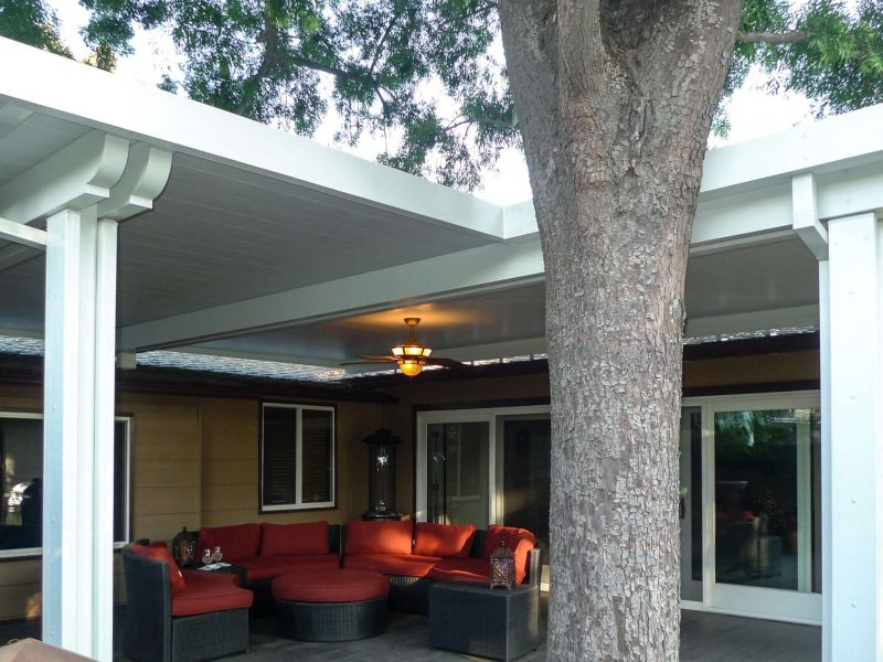 Exterior of a Solid Insulated Patio Cover with LED Lights and a Ceiling Fan in Santa Ana, CA