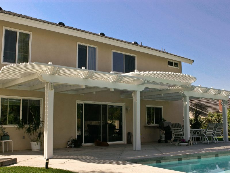 Exterior of an Open Lattice Patio Cover with radiused lattice cuts on side and front with LED Lights in Costa Mesa, CA