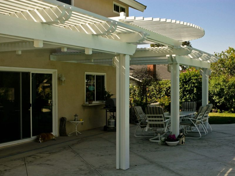 Exterior of an Open Lattice Patio Cover with radiused lattice cuts on front with LED Lights in Costa Mesa, CA