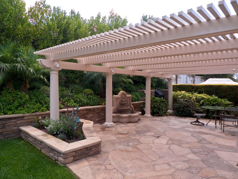 Exterior of an Open Lattice Patio Cover with Roman Columns & LED Lights in Irvine, CA
