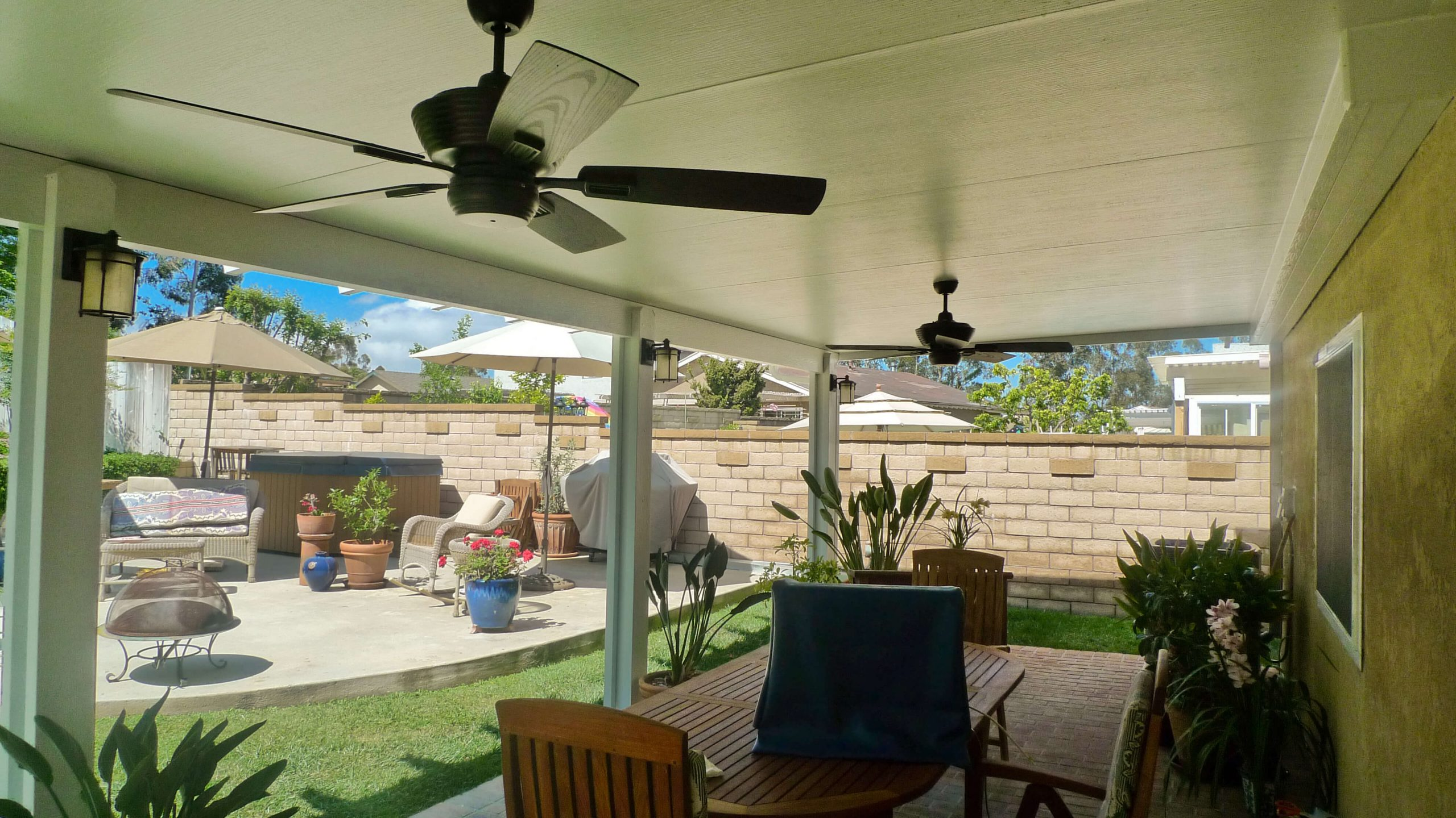 Underside of a Solid Insulated Patio Cover with 2 Ceiling Fans and LED Lights in Santa Ana, CA
