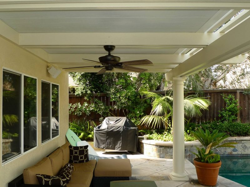 Underside of a Combination Open Lattice & Solid Insulated Patio Cover showing a Roman Column, speakers and a ceiling fan in Rancho Santa Margarita, CA