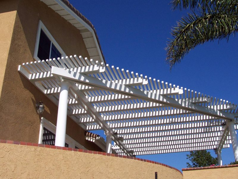 Exterior of an Open Lattice Patio Cover with LED Lights & Roman Columns in Anaheim Hills, CA