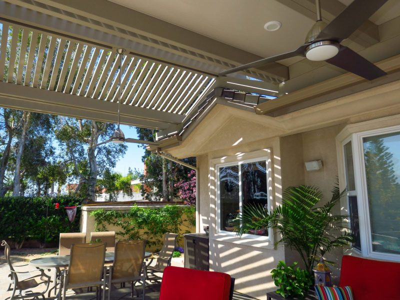 Underside of a Combination Open Lattice & Solid Insulated Patio Cover showing a close up detail of the gabled lattice section and a ceiling fan in Yorba Linda, CA