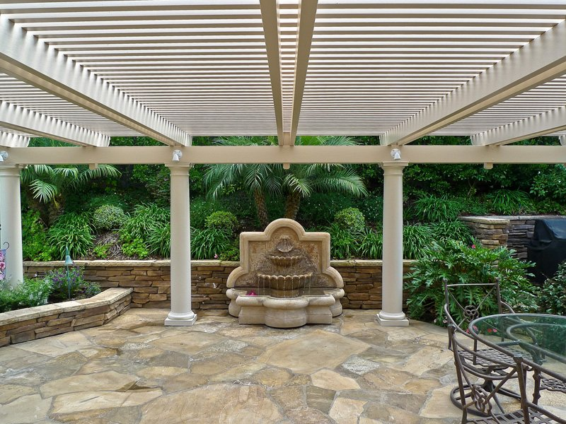Open Lattice Patio Cover in garden with roman columns facing a garden fountain in Irvine, CA
